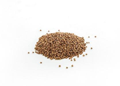 Brown buckwheat groats on white background