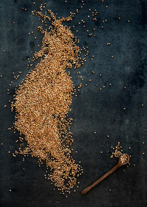 Brown buckwheat groats on dark grunge background