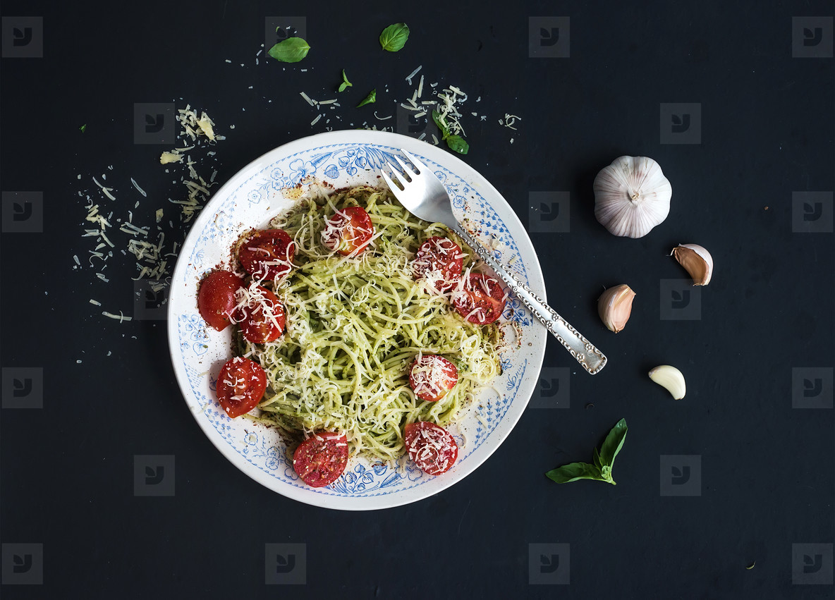 Pasta spaghetti with pesto sauce  basil  garlic  baked cherry tomatoes