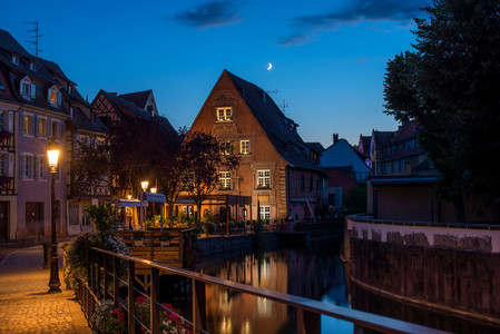 Traditional french houses on the side of chanel Petite Venise  Colmar  France  at night