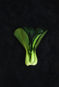 Pak choi on slate stone black background  top view