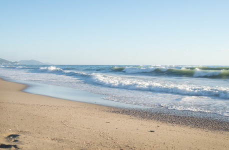 Big waves in the Mediterranean sea on a clear sunny day