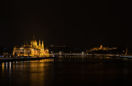 View of Hungarian Parliament Building  Royal Palace and Danube  river from Margit bridge at night