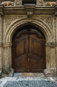 Medieval oak wood door in the old town center of Prague