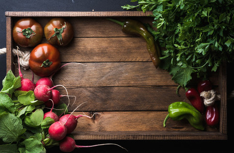 Fresh raw ingredients for healthy cooking or salad making on rustic wooden background  top view  copy space  Diet  vegetarian food concept