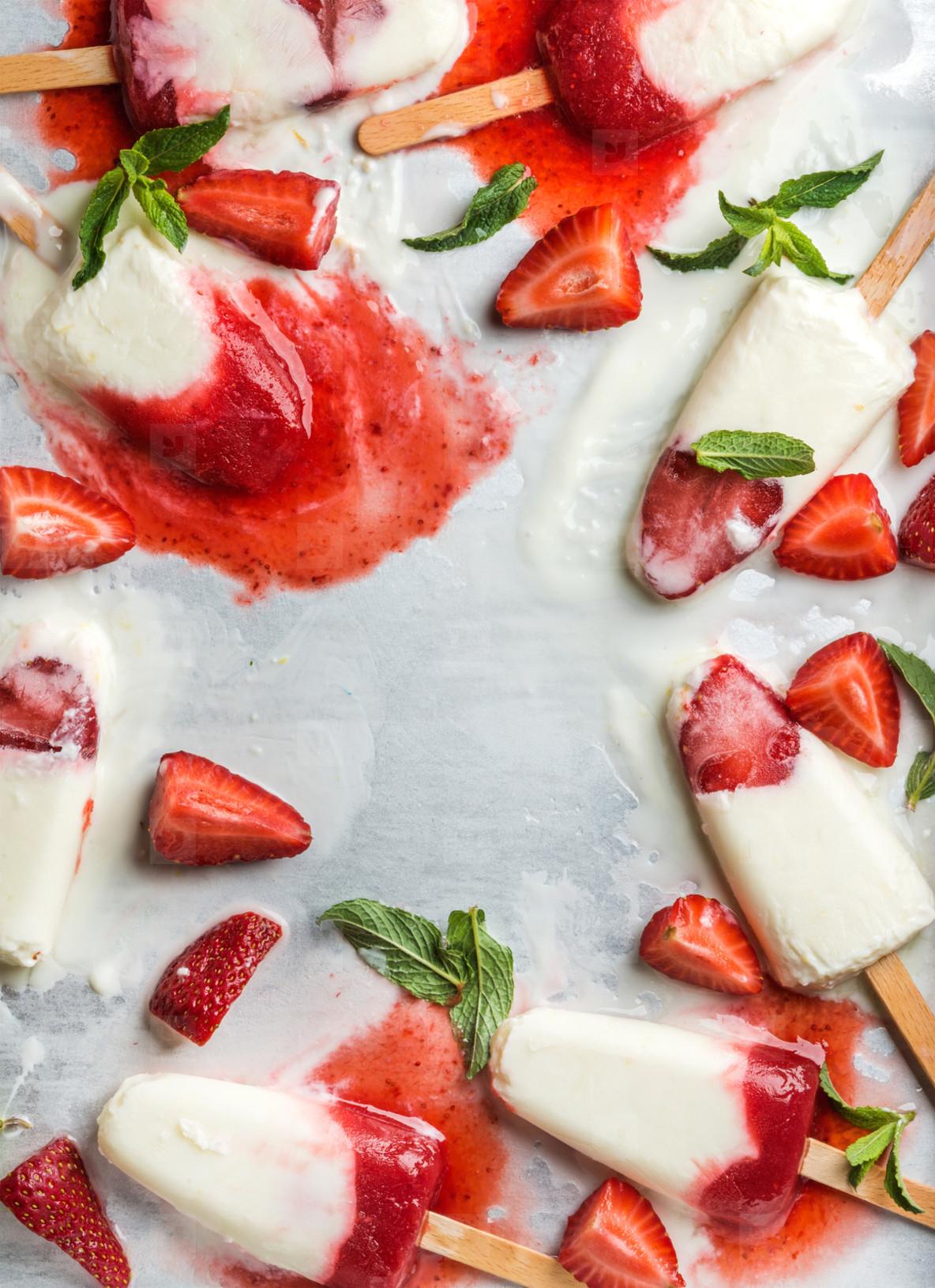 Strawberry yogurt ice cream popsicles with mint