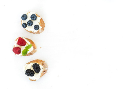 Goat cheese and berries mini sandwitches on white