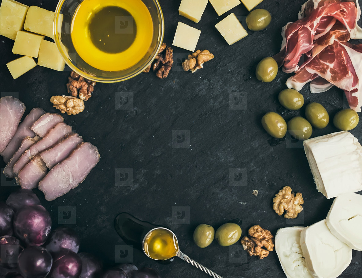 Wine appetizer set  cheese and meat selection with grapes  honey