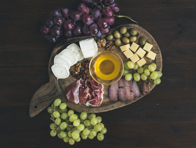 Wine appetizers set  meat and cheese selection  honey  grapes  w