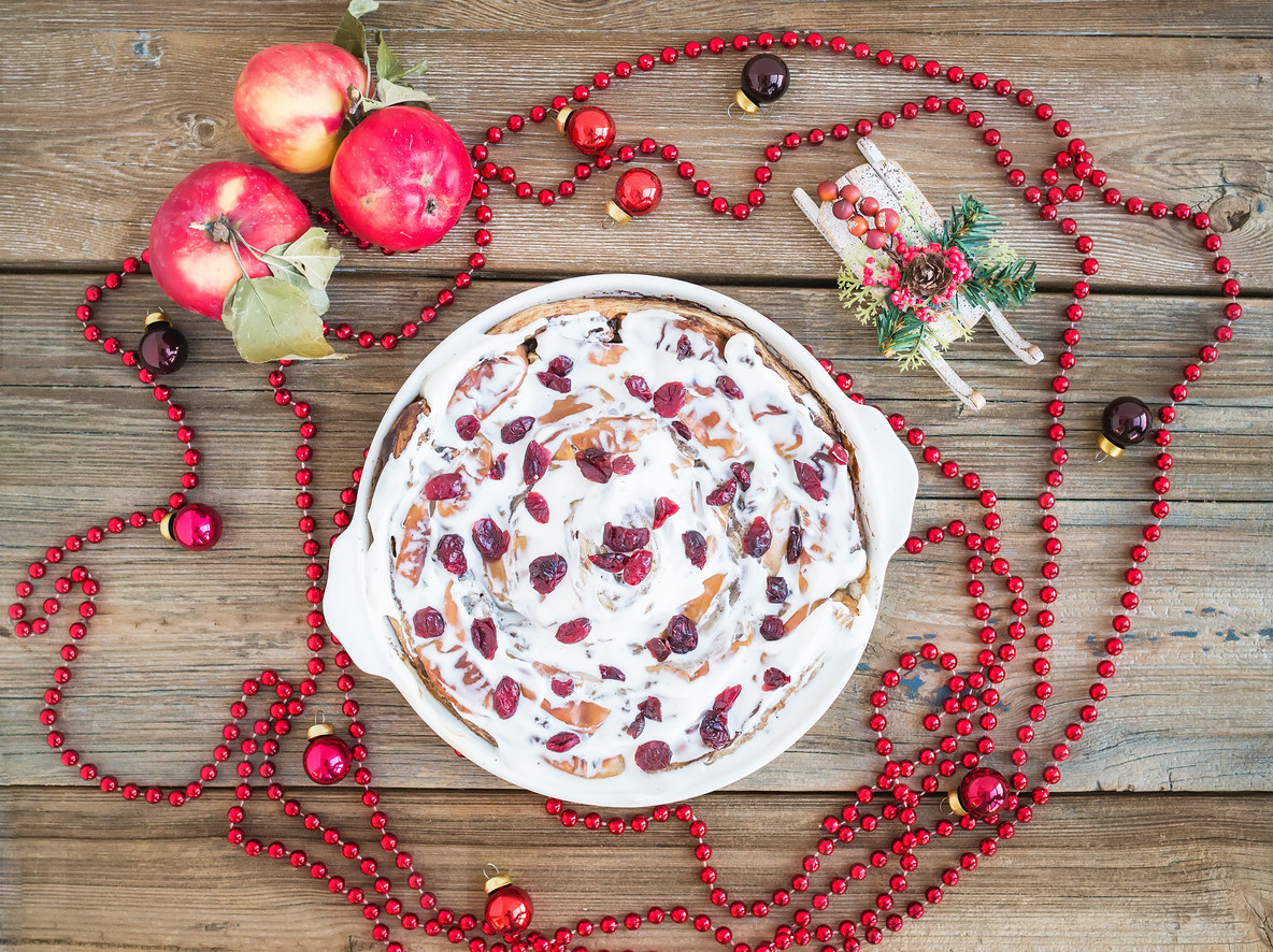 Apple  cranberry and cinnamon roll cake with creamy icing and Ch