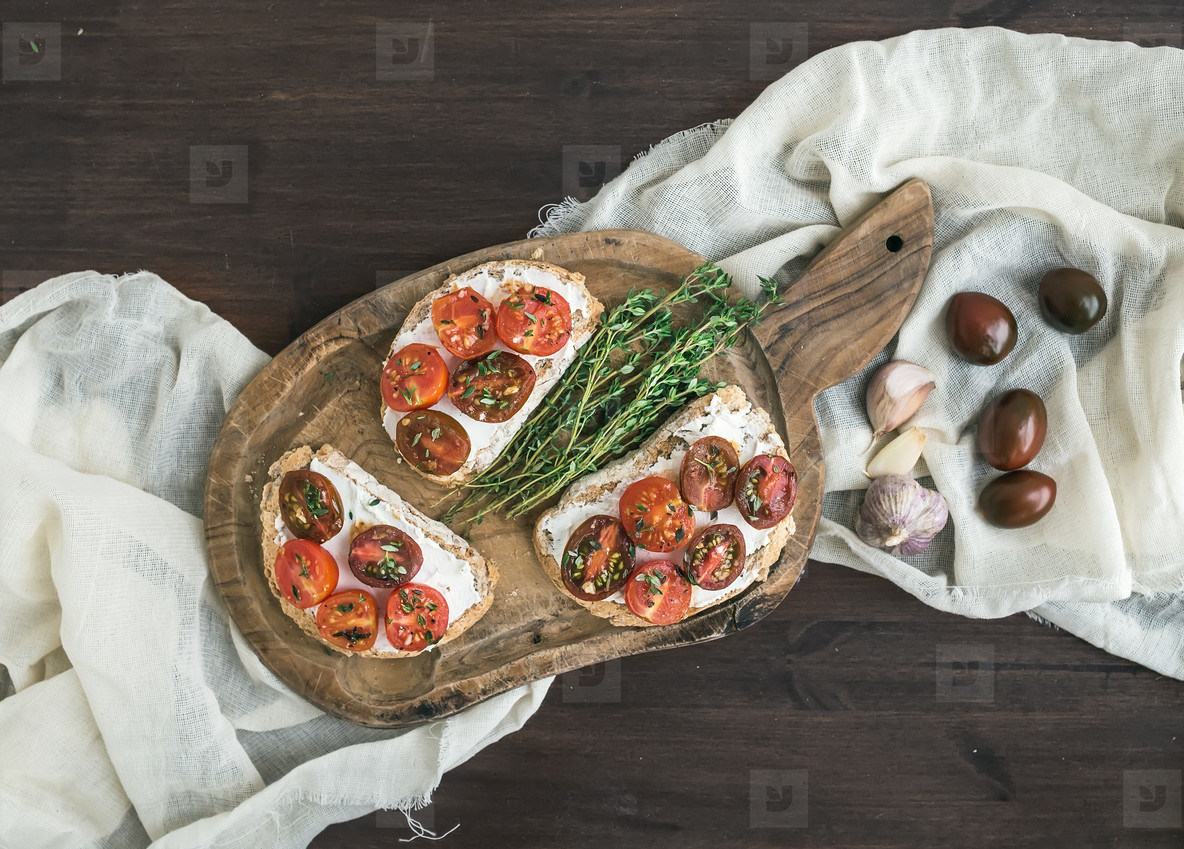 Sandwiches  brushtta  with roasted cherry tomatoes  soft cheese