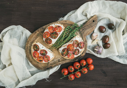 Sandwiches or brushettas with roasted cherry tomatoes  soft cheese