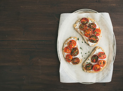 Ricotta and cherry tomato sandwiches with fresh thyme on a silve