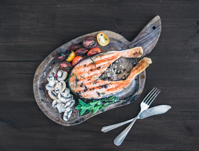Grilledsalmon steak with fresh herbs  roasted mushrooms  cherry