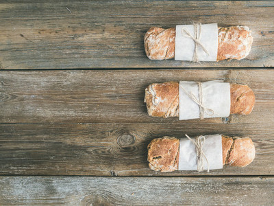 Freshly baked rustic  village bread  baguette  set on rough wood