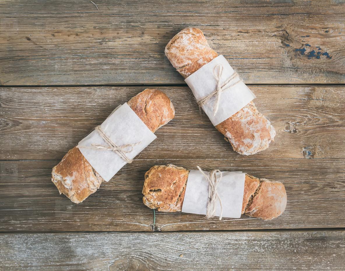 Freshly baked rustic  village bread  baguette  set on rough wood