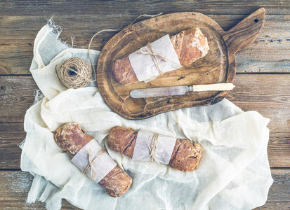 Freshly baked rustic village bread  baguettes  wrapped in paper