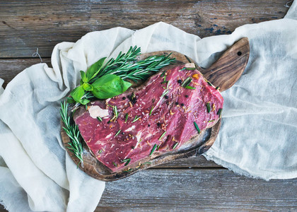A piece of raw fresh beef  Ribeye steak  marinated in spices and