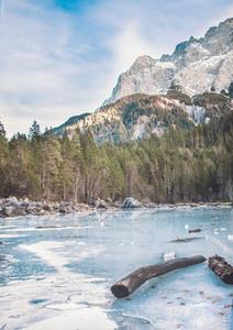 Frozen forest lake in Bavarian Alps near Eibsee lake  winter