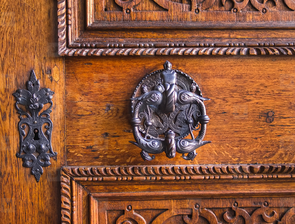 Medieval antique door handle and key hole