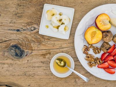 Breakfast set with fresh strawberry  banana  peach  dry figs  wa
