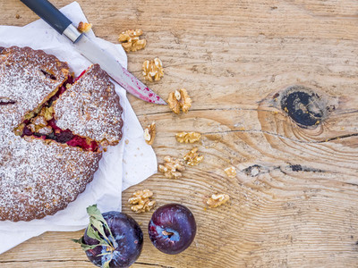 Plum cake with walnuts and fresh ripe plums