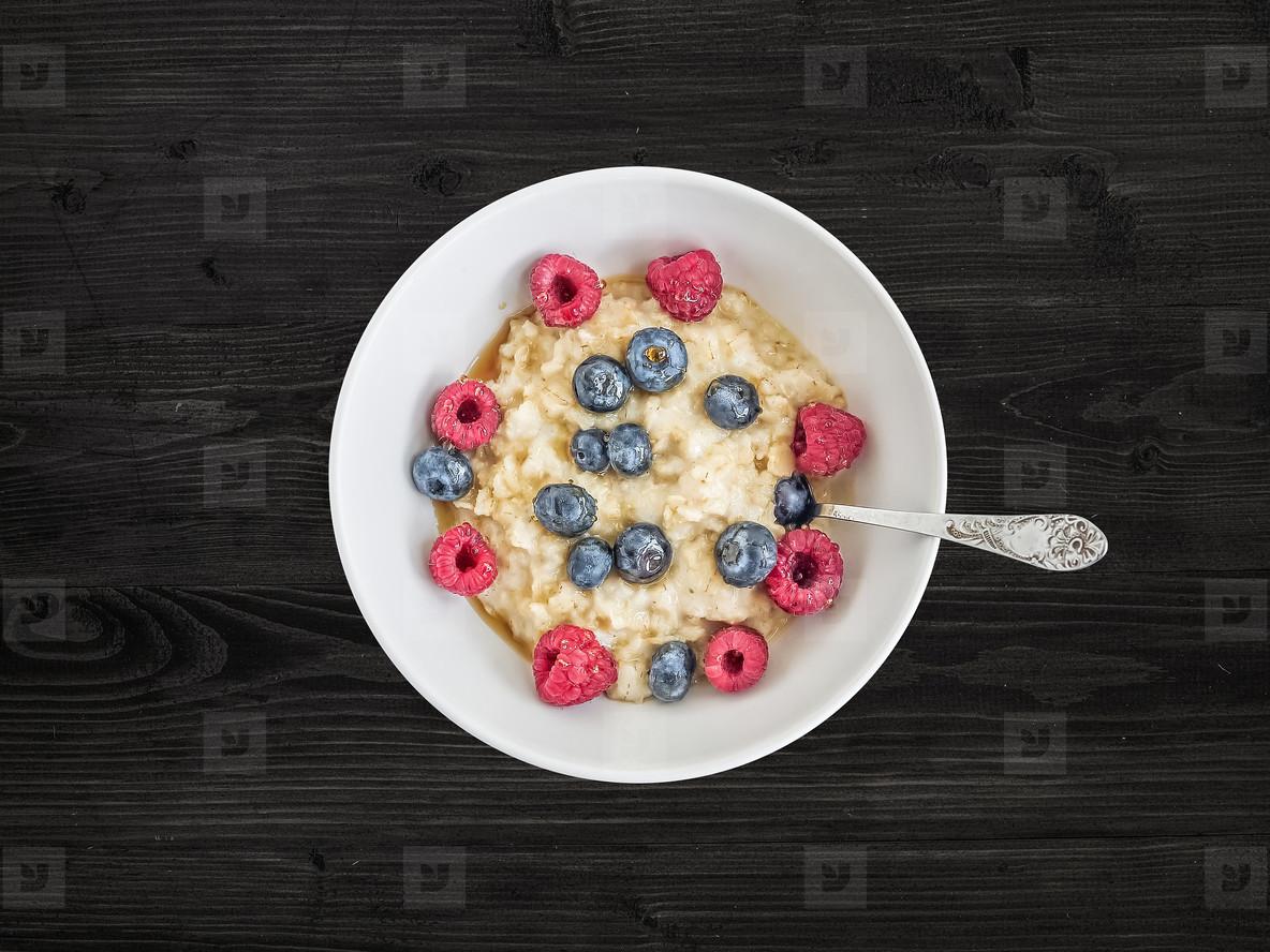 Oat porridge with fresh raspberry  blueberry and honey