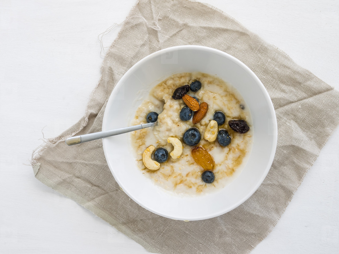 Oatmeal porridge with fresh blueberry  honey and nuts