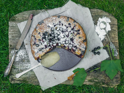 Blackberry pie on the old wooden desk