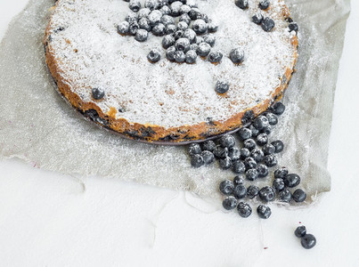 Blueberry pie on a white surface