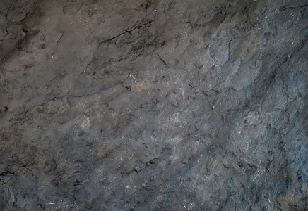 Dark gray natural slate stone texture or background