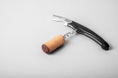 Wine cork and bottle opener