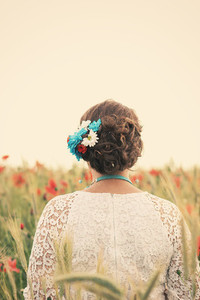 Bride on poppy field