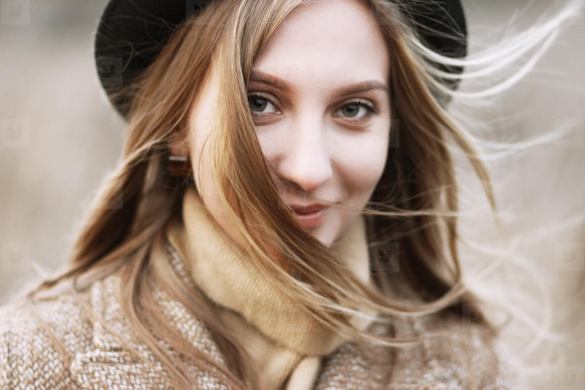 Beautiful smiley girl in hat