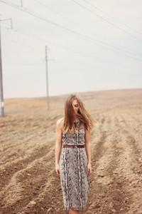 Beautiful girl on spring field