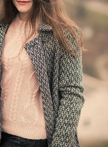 young beautiful woman in coat