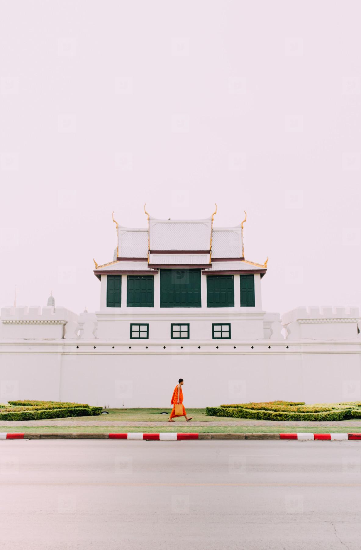 Monk walking pass temple