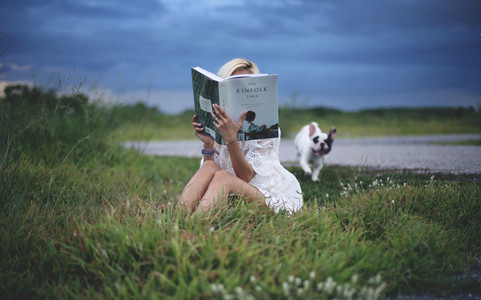 Young girl reading in nature