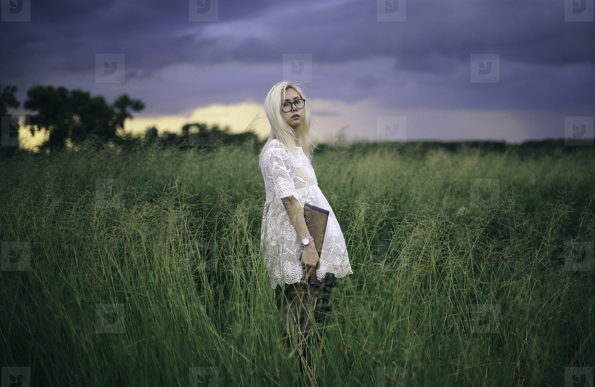 Young girl with a gun on nature