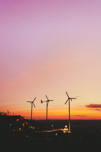 Small wind turbines in sunset