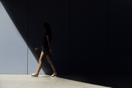 Woman walking between shadow