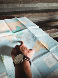 Man touching on world map