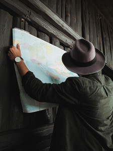 Traveler man searching on map