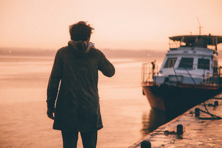Young man near a boat