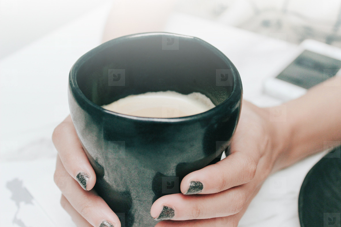 Woman holds hot cup of coffee