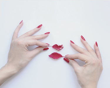 Red nails and leaves