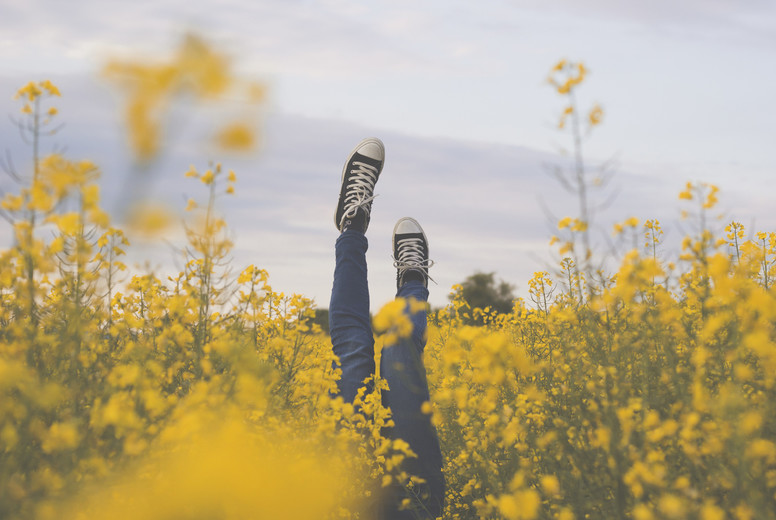 Girl upside down in rapeseed f
