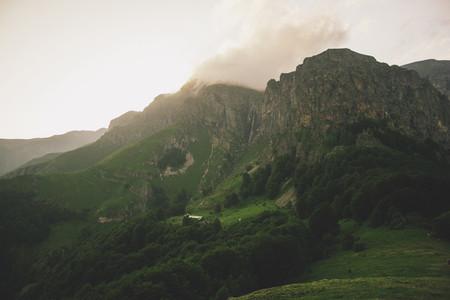 Mountain hut near a waterfall