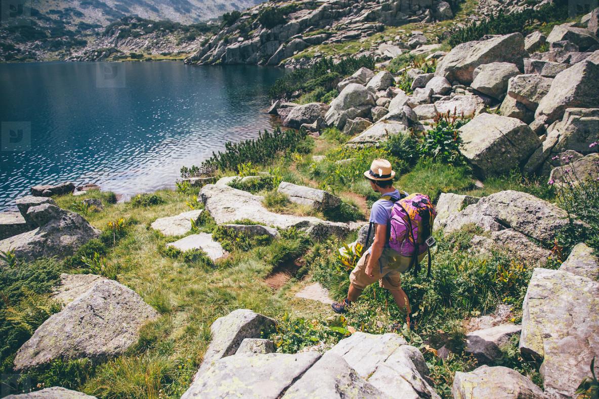 Young man near a mountain lake