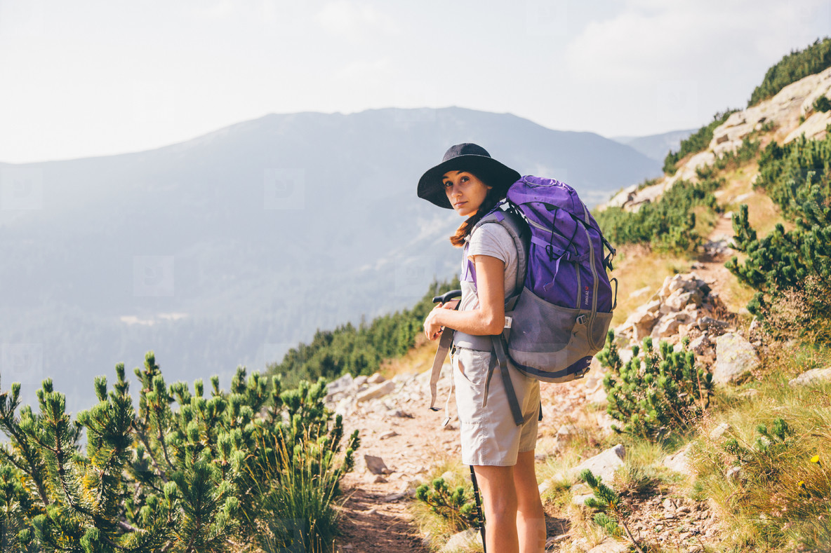 Girl hiking a mountain